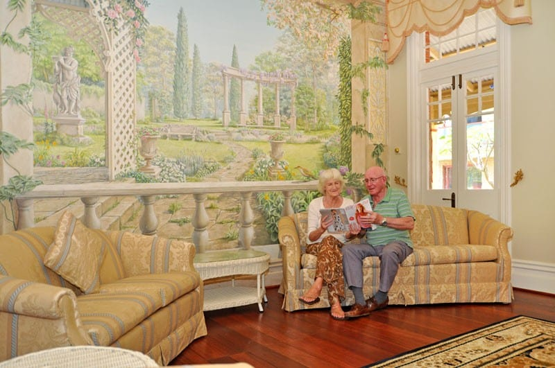 Old Couple Chilling on Sofa at Bicton Village