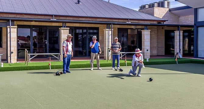 Seniors playing lawn bowls in mandurah retirement village