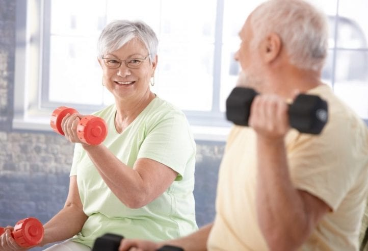 Lady and Man exercising with dumbbells